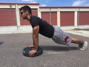 For the push-up to count, athlete must reach full extension of the elbow at the top and their body must stay rigid through-out the movement