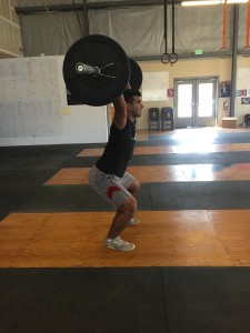 The athlete must receive every power snatch with their hips above their knees