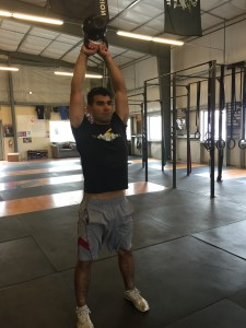 For Kettlebell swings to count, hip/knee/elbow extension is required and the bottom of the KB must be facing up